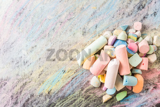 Chalks with colorful painted background. Back to school and art concept with copy space.