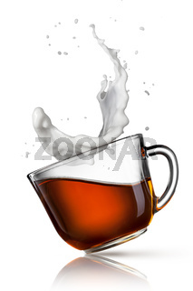 cup of black tea with milk splash isolated on white