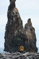 Woman looking at Ribeira da Janela islet in Madeira