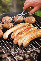 sausages and meatballs on a grill