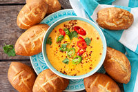 Cheese dip and bread rolls