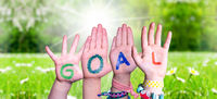 Children Hands Building Word Goal, Grass Meadow