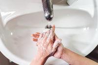 Man washing hands to protect against the coronavirus