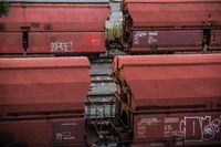 red train container on railroad