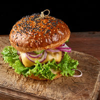 burgers with fried beef cutlet, tomato, lettuce and onions, crispy white wheat flour bun with sesame seeds