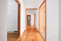 corridor in renovated, empty flat with wooden floor