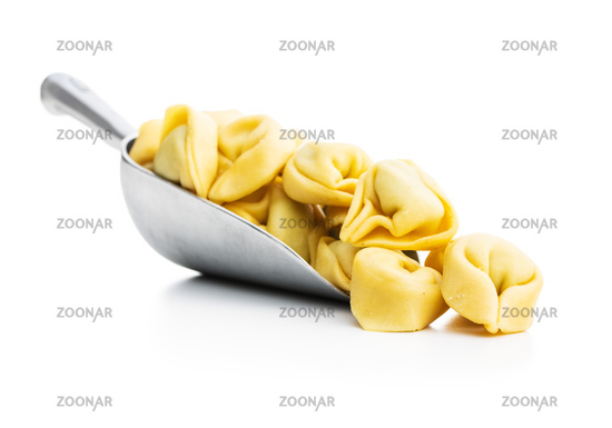 Tortellini pasta. Italian stuffed pasta in scoop.