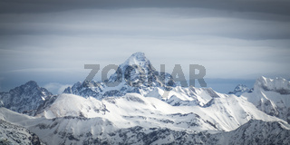 Amazing dramatic Winter panoramic View to the snow covered Mountain Hochvogel in Allgau Alps, Bavaria, Germany.