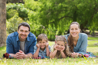 Portrait of parents and kids lying at park