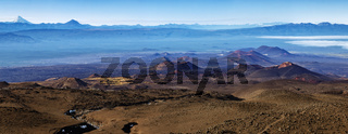 Stunning panorama volcano landscape of Kamchatka Peninsula: series of volcanic cones and lava plain