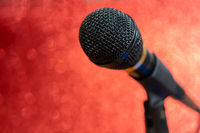 Professional dynamic microphone. Concert microphone for voice recording and sound enhancement. Sound equipment.