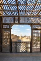 Passage surrounding Ibn Tulun Mosque framed by wooden perforated wall - Mashrabiya - Cairo, Egypt