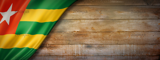Togo flag on vintage wood wall banner