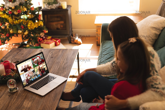 Caucasian woman with her daughter at christmas on a video call