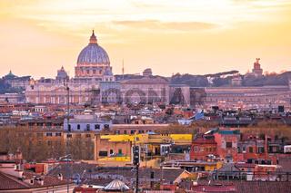 Eternal city of Rome rooftops and Vatican Basilica of Saint Peter golden sunset view