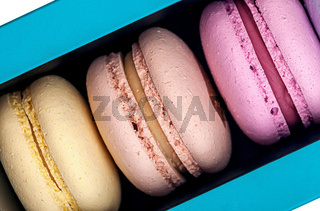 Three macaroons in box closeup