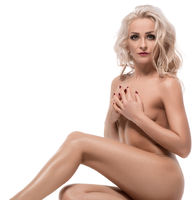 Slim naked blonde on the floor isolated shot
