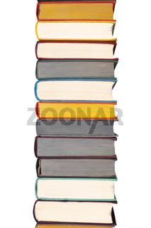 Stack of hardcover books on bookshelf. Close up view of hardback books isolated on white background