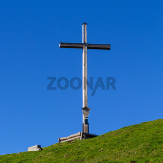 Summit Cross of Mount Rauheck, 1590 m in Bavarian Prealps, located near Ohlstadt, Upper Bavaria, Germany. Europe