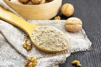 Flour walnut in spoon on napkin