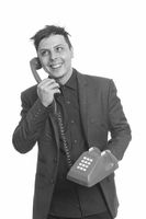Portrait of happy businessman talking on the telephone