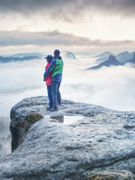 Happy romantic loving hikers couple at misty valley
