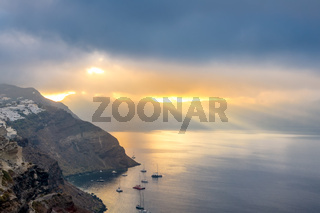Caldera of Santorini and Rays of the Sun Through Heavy Clouds
