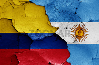 flags of Colombia and Argentina painted on cracked wall