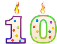 Ten years anniversary, 10 number shaped birthday candle with fire on white
