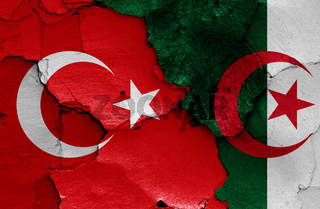 flags of Turkey and Algeria painted on cracked wall