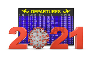 Coronavirus and 2021 next to departure board