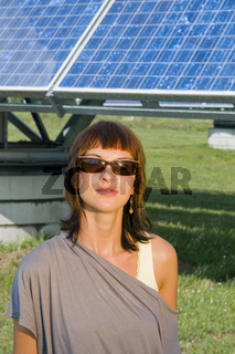 girl by the solar cells