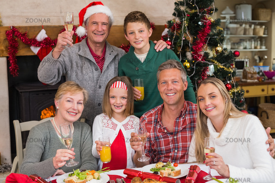 Family toasting with white wine in a christmas dinner