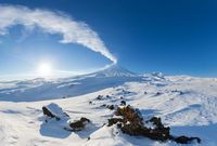 Kamchatka Peninsula, winter mountain landscape, beautiful panoramic view of eruption active volcano
