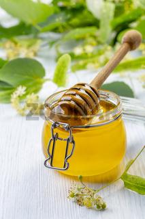 Organic honey and wooden dipper.