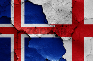 flags of Iceland and England painted on cracked wall