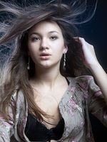 Beautiful woman with magnificent hair. Fashion photo on black background