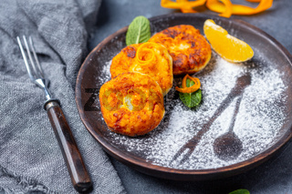 Homemade cottage cheese pancakes with orange zest.
