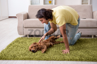 Young man with cocker spaniel dog