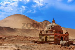 Small mosque like building in the deserts of The Faming Mountains in Xinjiang
