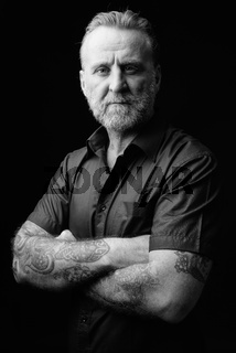 Mature handsome bearded man in black and white