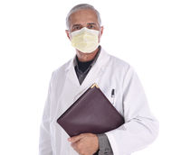 Portrait of a middle aged doctor wearing a surgical mask and lab coat holding a notebook under his a
