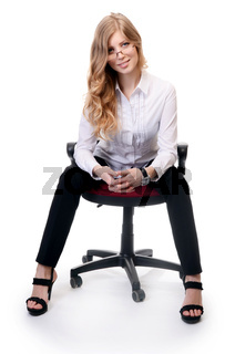 Businesswoman in an armchair isolated on white background