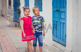 Kids walking by the street