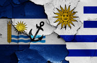 flags of Rio Negro Department and Uruguay painted on cracked wall