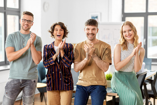 happy business team applauding at office