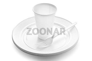 Plastic dishware. White vase, plate and fork on white background