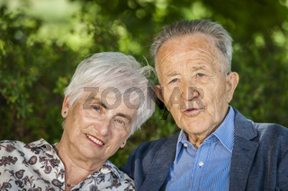 Portrait old retired couple side by side