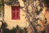 window with red shutter  of Anafiotika in town of Athens,Greece.