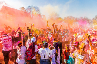 Young people having fun at The Color Run 5km Marathon, Bright color paint all over a large crowd South Africa,  05/21/2017, The Color Run